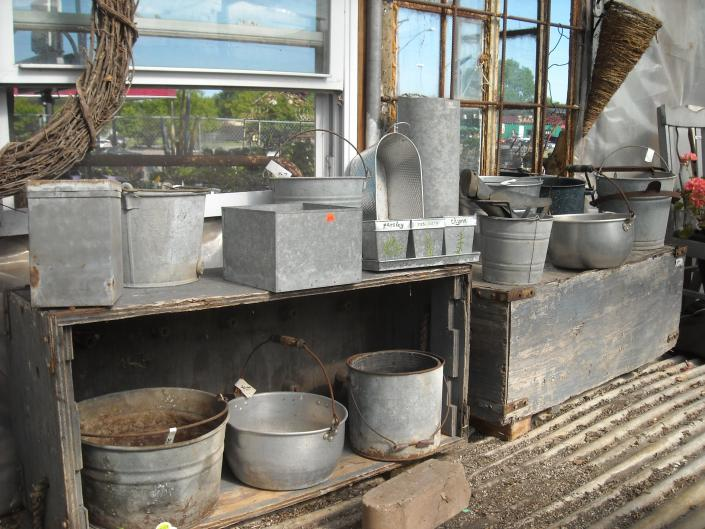 Large assortment of vintage metal containers for plants